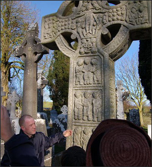 Kieran Cathcart speaking in front of celtic cross